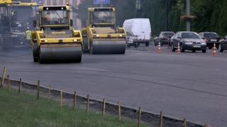 Kiev, Ukraine - 27. 07. 2016. Vibratory compactors on road. Repairing of interstate roads. Finish all work in time.