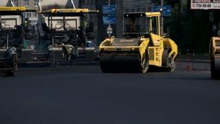 Kiev, Ukraine - 27. 07. 2016. Yellow asphalt compactor. Machine facilitates labor. Fast construction of roads.