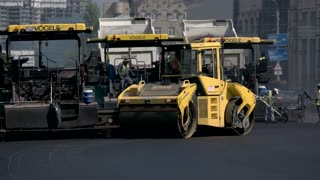 Kiev, Ukraine - 27. 07. 2016. Yellow colored asphalt roller. Quality repair of roadway. Machines facilitate work of people.