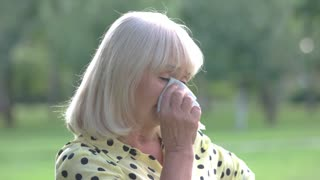 Lady wiping eyes with handkerchief. Sad senior woman. I lost everything I had. Difficult period of life.
