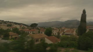 Landscape in train window. Town buildings and mountains. Relax and admire picturesque views.