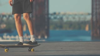 Legs of skater performing trick. Person with skateboard outdoors. Born to skate. Sport in my blood.