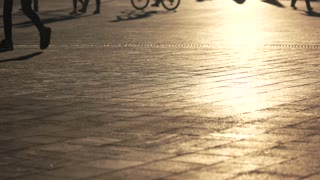 Legs perform skateboarding trick. Shadow of skater on pavement. Adrenaline for youth. Sportsman is sharpening skills.