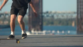 Legs performing a skate trick. Person with skateboard outdoor. Need to improve my skills. Talent and stubbornness.