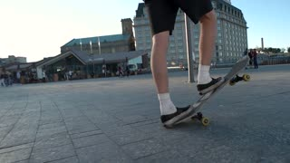 Legs riding a skateboard. Skater in the street. Freedom and boldness. Pick up speed.