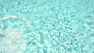 Light blue water texture. Clean water and sunlight. Dive into summer.