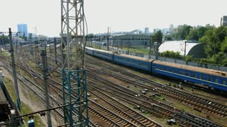 Long passenger train arrives at the station.
