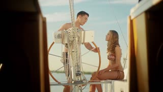 Loving couple relaxing on a yacht. Love story. Guy and the girl relaxing at the weekend on a yacht. Rest at the sea. Honeymoon.