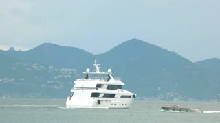 Motor yacht near coast. Luxury life and far travels.