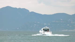 Motor yacht on water. Sea travel to France.