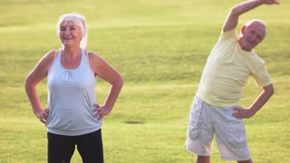 Old man doing exercise. Lady showing thumb up. Feeling strong and healthy. Start your day with training.