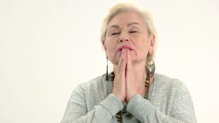 Old woman praying isolated. Senior lady with closed eyes. Cleanse your mind.