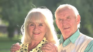 Older couple outdoors. Smiling woman with man. Always support each other. Together in happiness and grief.