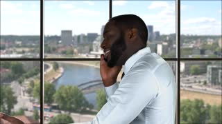 Phone talking on city background. Black guy with cellphone. Start business from a scratch.