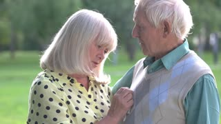 Sad senior couple. Man talking to a woman. How to settle a conflict. Trust and understanding.