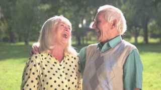 Senior couple is laughing. Elderly people outdoor. You're my happiness. Emotions and expressions.