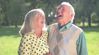 Senior couple is laughing. Man and woman outdoors. Funniest joke I've ever heard. Great mood for whole day.
