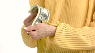 Senior woman holding money isolated. Hands of lady counting cash. Choose best pension fund.