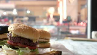 Side view of tasty burgers. Sesame bun cheeseburger. Best fast food deals.