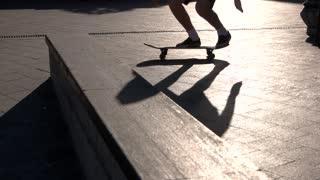 Skateboarder does stunt in slow-mo. Feet standing on a skateboard. Pop shove it 360 tutorial. Let it spin.