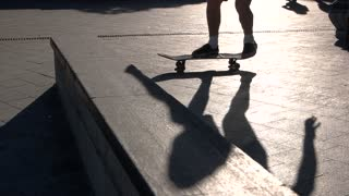 Skateboarder doing stunt in slow-mo. Feet of a skateboarder. 360 pop shove it. Talent and skills.