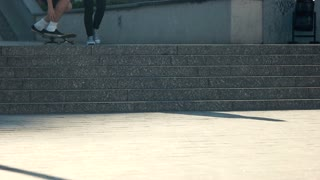 Skateboarder doing trick in slow-mo. Guy with skateboard. Kickflip gone wrong. Need time to sharpen skills.