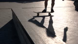 Skateboarder failed a trick. Feet and a skateboard. Accept the failure. Find motivation to go on.