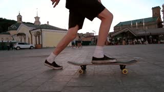 Skateboarder riding in slow-mo. Side view of a skateboard. Generation of freedom. Do what you like.