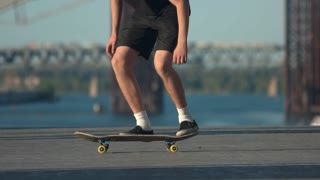 Skater doing trick in slow-mo. Person on skateboard outdoor. Young and free. Find hobby that suits you.