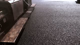 Texture of black asphalt. Machines moving on the road. Build roads from quality materials. New plan of work.