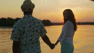 Travel to the islands. Walk on the yacht. Guy and a girl enjoy the sunset from the yacht.