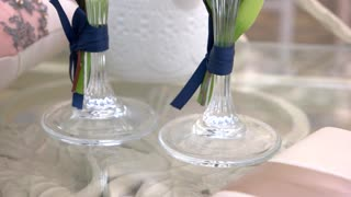 Two champagne glasses. Beverage with small bubbles. Drink for bride and groom.