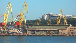 02. 08. 2017, Odessa, Ukraine. Industrial port with cranes and ships. Industrial container freight Trade Port scene at dusk.