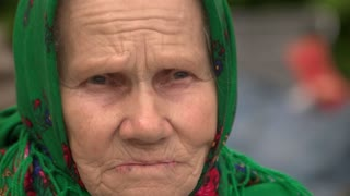09. 05. 2018, Ukraine, Kiev. Close up portrait of sad wrinkled old lady.