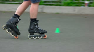 09. 05. 2018, Ukraine, Kiev. Roller skater legs riding with agility markers. Close up. Unrecognizable man.