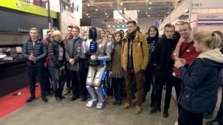 13. 12. 2016 - Ukraine, Kiev. Robot and people. Friendship of human and machine.