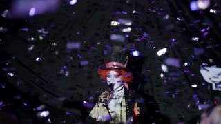 14. 01. 2016 Kiev, Ukraine. Mad Hatter showman. Night party in club. Cheerful young people showered with confetti on a club party. Friends in masquerade costumes.