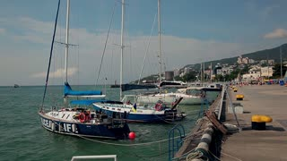 15. 17. 2012 Crimea, Ukraine. Sailboats moored to the sea promenade.