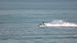 16. 08. 2016 - Odessa, Ukraine. Guy riding jet ski, slow-mo. Personal watercraft for sale.