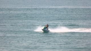 16. 08. 2016 - Odessa, Ukraine. Man on jet ski, slow-mo. Speed, adrenaline and fun.