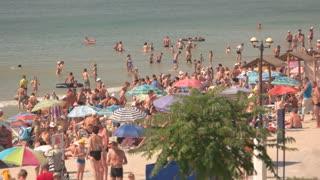 16. 08. 2016 Odessa,Ukraine. City summer beach. Many people swim and sunbathe. Very hot day. Good weather for a beach holiday.