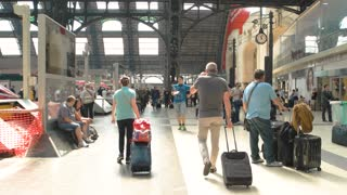 18. 06. 2016 - Milan, Italy. Bustling train station. People with luggage.