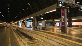 18. 06. 2016 - Milan, Italy. Modern electric locomotive, passenger train. Railway station platform at night.