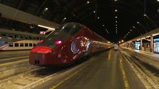 18. 06. 2016 - Milan, Italy. Modern passenger train, night. Empty railway station platform.