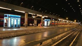 18. 06. 2016 - Milan, Italy. Railway station, night. Passenger train near the platform.