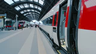 18. 06. 2016 - Milan, Italy. Train conductor at the station. Passenger trains and people. Railway jobs and qualification.