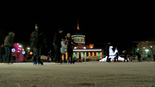 21. 01. 2017 - Kiev, Ukraine. Slowly skating people. Decorated Christmas castle in the background.