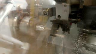 Action of lathe. Metal turning machine.