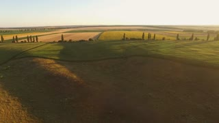 Aerial view of fields. Cloudless sky at sunrise. Vastness of nature. Picturesque rural scenery.