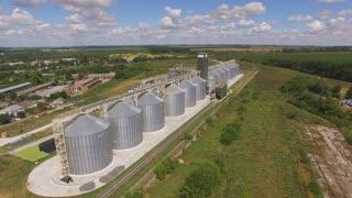 Aerial view of grain bins. Wheat field.